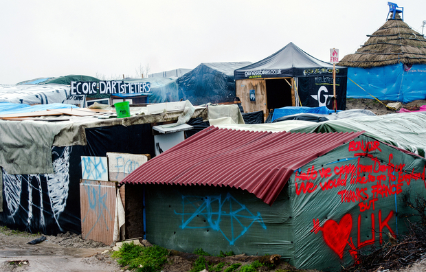 "A picture taken on February 22, 2016 in Calais shows the ""Jungle"" migrants and refugee camp. Local French government authorities said on February 12 they want to move up to 1,000 migrants living in the ""Jungle"" camp in Calais. They could be housed in a new centre of converted shipping containers which was set up this winter and can house up to 1,500 migrants, or in other centres around France. But, according to humanitarian associations the number of people living in the camp is up to 3.450 and not 1.000 as mentioned by the government. / AFP / DENIS CHARLET"